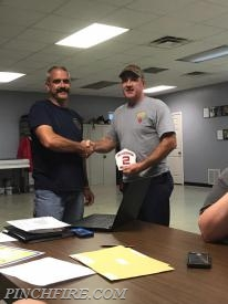 Lieutenant Hodge receives his new shield from Chief Wagoner.