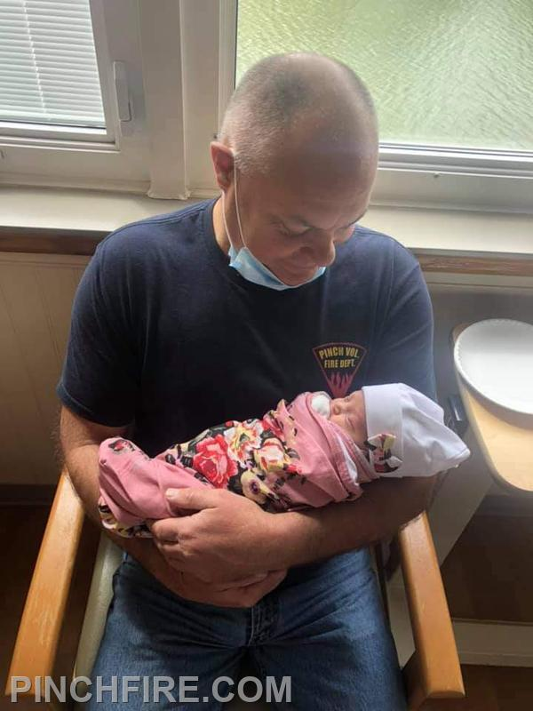 Firefighter Aaron Lilly and Granddaughter